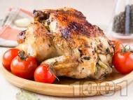 Пълнено цяло пиле с картофи и подправки печено под фолио на фурна